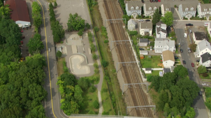 HD stock footage aerial video of a bird's eye view of train tracks, reveal soccer field in Hyde Park, Massachusetts Aerial Stock Footage | AF0001_000701