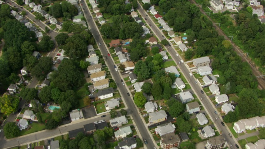 HD stock footage aerial video of a bird's eye view of residential neighborhoods in Hyde Park, Massachusetts Aerial Stock Footage | AF0001_000702