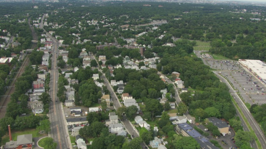 Tilt from homes in Hyde Park to reveal the skyline of Downtown Boston, Massachusetts Aerial Stock Footage | AF0001_000704
