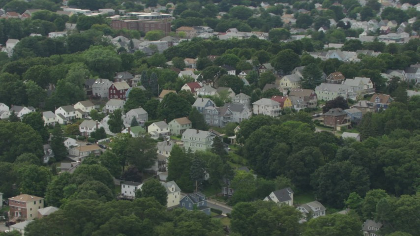 Flyby a suburban residential neighborhood, Hyde Park, Massachusetts Aerial Stock Footage | AF0001_000705