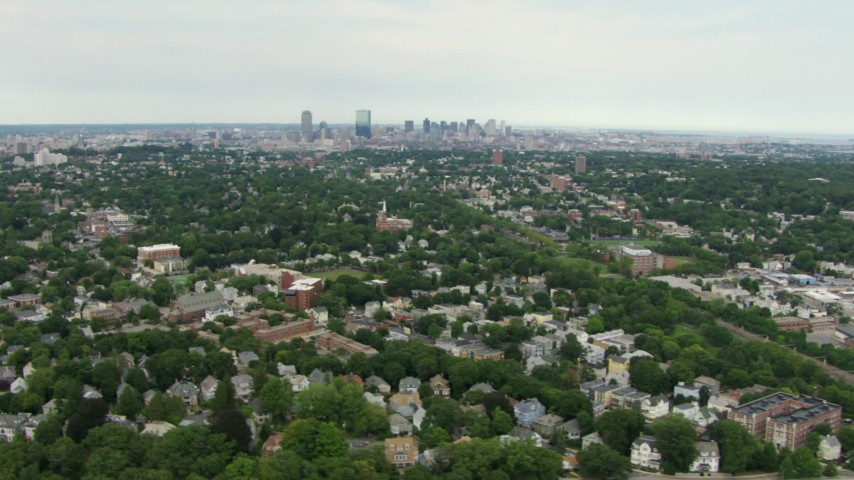 HD stock footage aerial video of the skyline of Downtown Boston, Massachusetts seen from suburban neighborhoods in Jamaica Plain Aerial Stock Footage | AF0001_000709