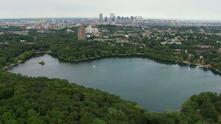 HD stock footage aerial video flyby Jamaica Plain homes with a view of Downtown Boston, reveal Jamaica Pond, Massachusetts Aerial Stock Footage | AF0001_000710