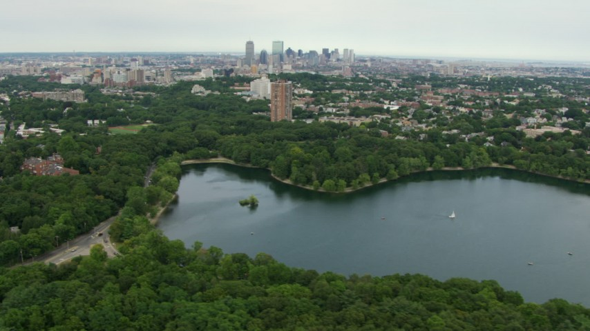 HD stock footage aerial video of Downtown Boston seen from Jamaica Pond, Massachusetts Aerial Stock Footage | AF0001_000711