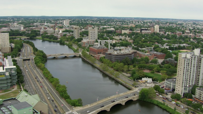 HD stock footage aerial video office buildings across the Charles River, reveal Harvard University, Cambridge, Massachusetts Aerial Stock Footage   AF0001_000718