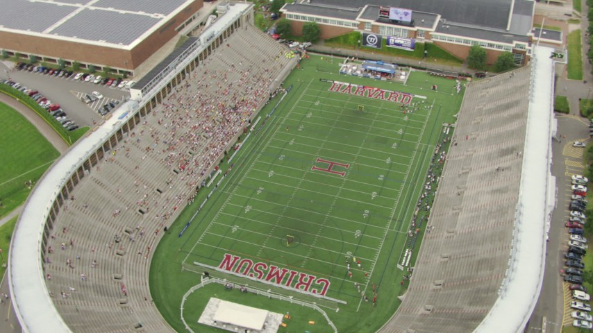 HD stock footage aerial video orbit Harvard Stadium with fans in the stands at Harvard University, Cambridge, Massachusetts Aerial Stock Footage | AF0001_000721
