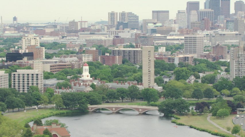 HD stock footage aerial video flyby Dunster House at Harvard University, reveal Downtown Boston, Massachusetts Aerial Stock Footage | AF0001_000722