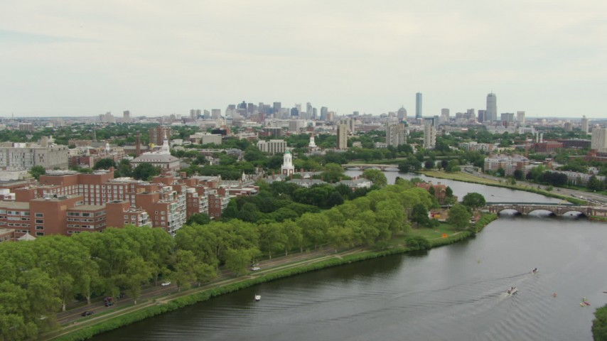HD stock footage aerial video fly over Charles River toward Eliot House at Harvard University, Cambridge, Massachusetts Aerial Stock Footage | AF0001_000723