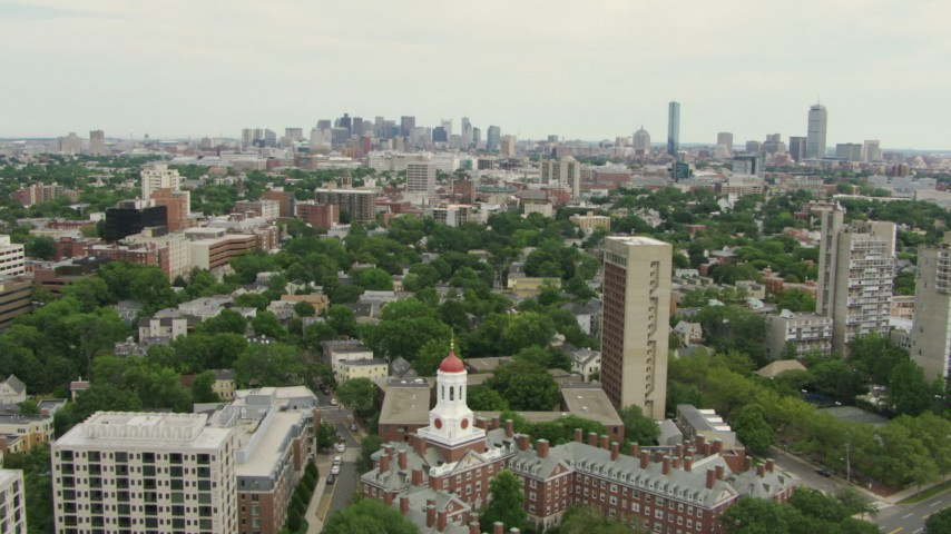 Fly over Dunster House at Harvard University to approach Cambridge and Downtown Boston, Massachusetts Aerial Stock Footage | AF0001_000725