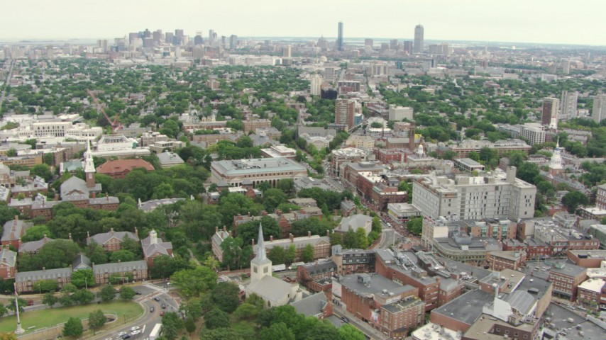 HD stock footage aerial video tilt from Memorial Library at Harvard University to reveal Downtown Boston, Massachusetts Aerial Stock Footage | AF0001_000732