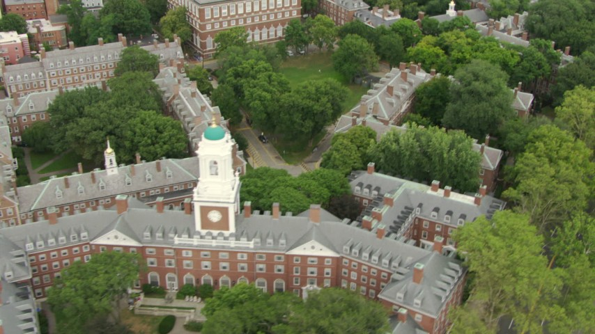 Flyby Eliot House, tilt up to reveal Lowell House and Harvard University campus in Cambridge, Massachusetts Aerial Stock Footage | AF0001_000734