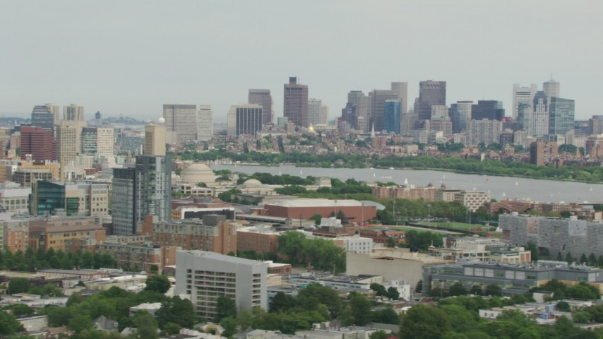 HD stock footage aerial video of Downtown Boston skyline and the Charles River seen from across Cambridge , Massachusetts Aerial Stock Footage | AF0001_000736