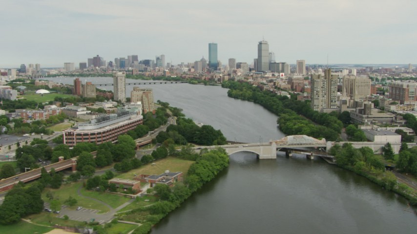 Follow the Charles River over Boston University Bridge to approach Downtown Boston, Massachusetts Aerial Stock Footage | AF0001_000737