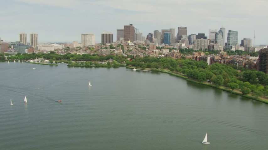 HD stock footage aerial video approach Charles River Esplanade, Beacon Hill, and the city skyline, Downtown Boston, Massachusetts Aerial Stock Footage | AF0001_000741