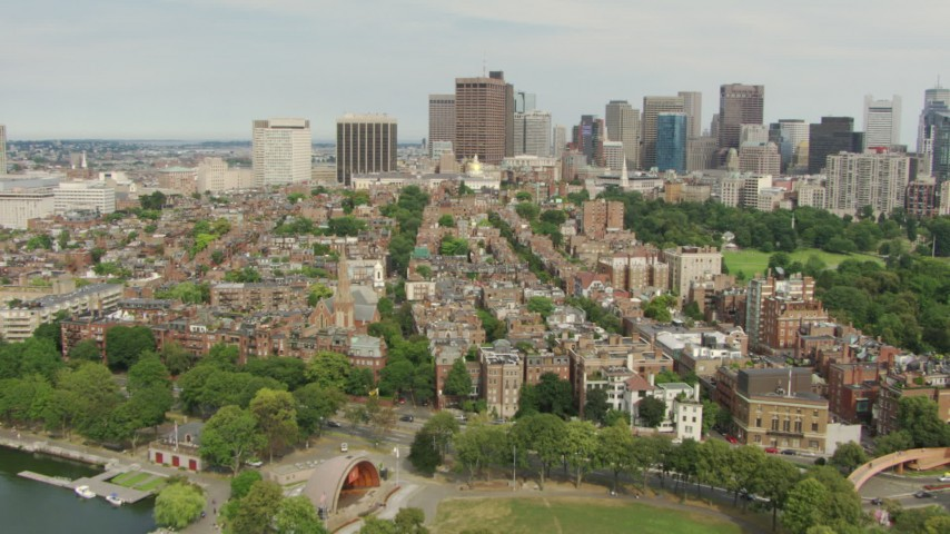 Fly over the Hatch Memorial Shell and Beacon Hill to approach Massachusetts State House, Downtown Boston, Massachusetts Aerial Stock Footage | AF0001_000742