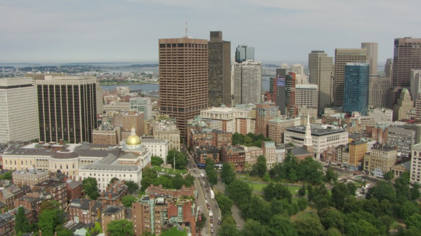 HD stock footage aerial video flyby Massachusetts State House, reveal skyscrapers in Downtown Boston, Massachusetts Aerial Stock Footage | AF0001_000745