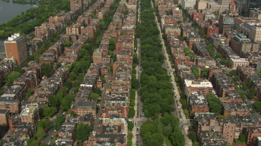 Flying over Victorian brownstones and streets in Back Bay, Downtown Boston, Massachusetts Aerial Stock Footage AF0001_000758 | Axiom Images