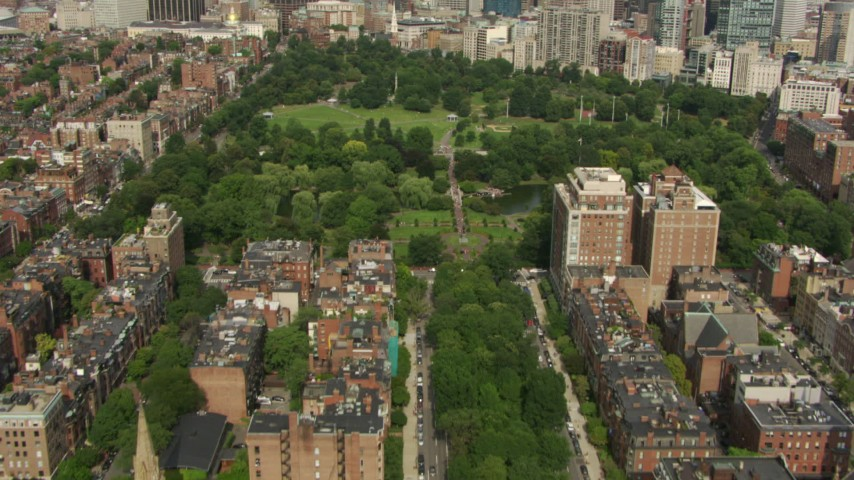 HD stock footage aerial video fly over Victorian brownstone homes, reveal Boston Common and Downtown Boston, Massachusetts Aerial Stock Footage | AF0001_000759