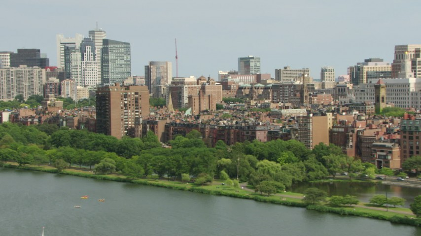 HD stock footage aerial video of Back Bay brownstone homes near skyscrapers in Downtown Boston, Massachusetts Aerial Stock Footage | AF0001_000764