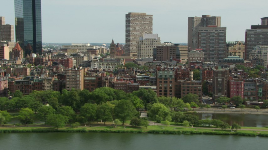 Back Bay Victorian brownstones seen from the Charles River in Downtown Boston, Massachusetts Aerial Stock Footage AF0001_000765 | Axiom Images