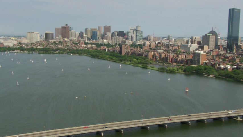 HD stock footage aerial video pan across boats on the Charles River and the city skyline of Downtown Boston, Massachusetts Aerial Stock Footage | AF0001_000775