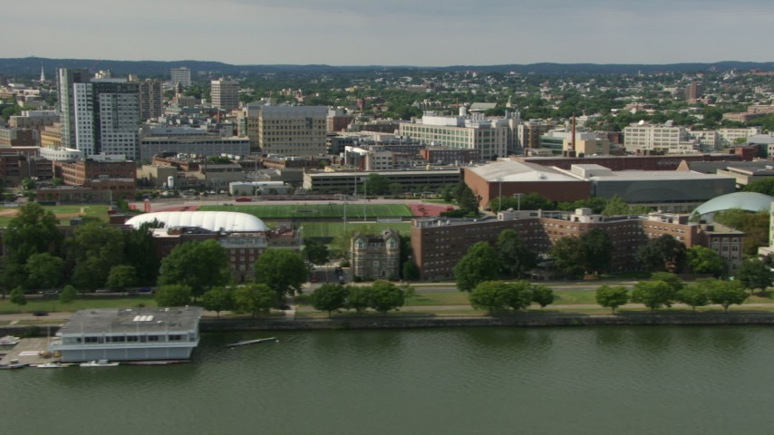 Flyby the riverfront campus of the Massachusetts Institute of Technology, Cambridge, Massachusetts Aerial Stock Footage | AF0001_000781