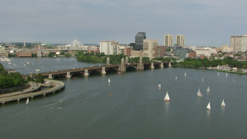 Fly over sailboats on the Charles River to approach the Longfellow Bridge, Boston, Massachusetts Aerial Stock Footage | AF0001_000783