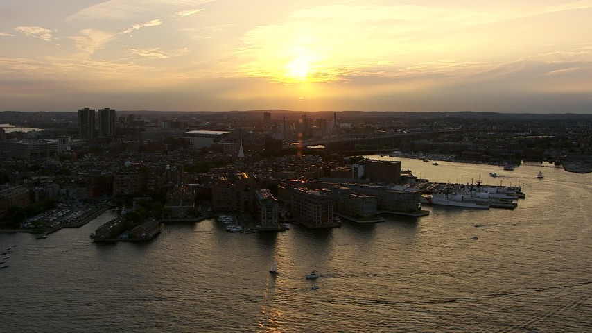 Flyby wharfs and the United States Coast Guard Base on the North End, Downtown Boston, Massachusetts, sunset Aerial Stock Footage AF0001_000787