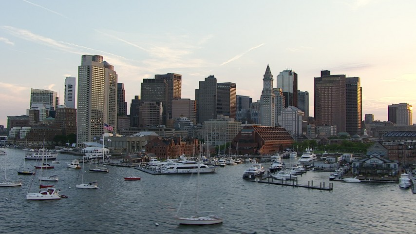 Flyby boats in the marina and skyscrapers in Downtown Boston, Massachusetts, sunset Aerial Stock Footage AF0001_000788 | Axiom Images