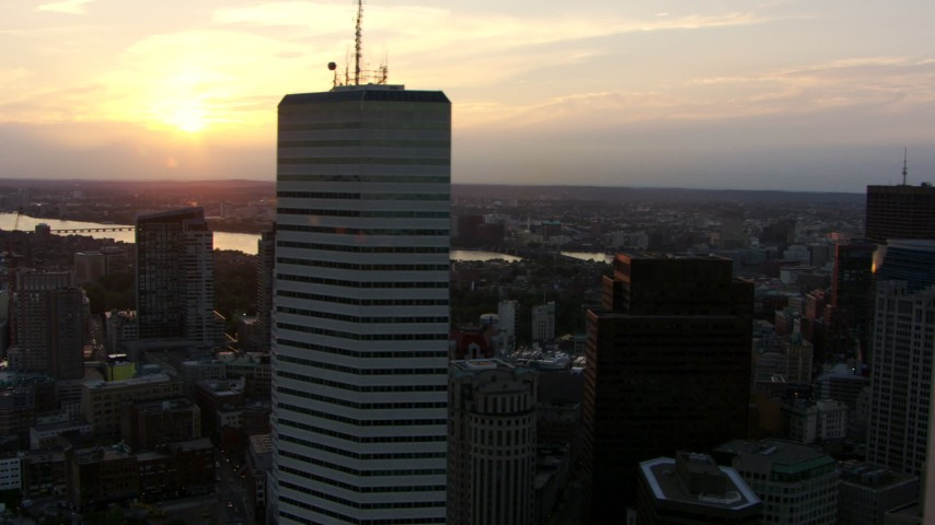 HD stock footage aerial video flyby city skyscrapers in Downtown Boston, Massachusetts, at sunset, with a view of the Charles River Aerial Stock Footage | AF0001_000794