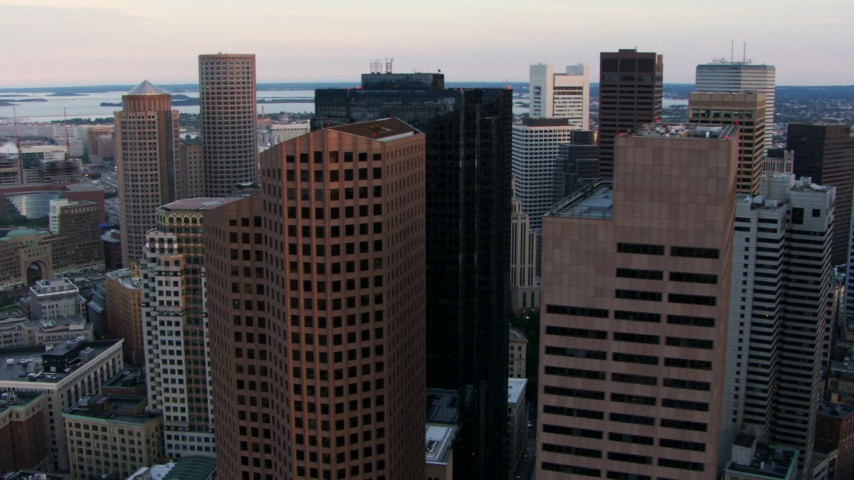 HD stock footage aerial video of tall skyscrapers and city buildings in Downtown Boston, Massachusetts, twilight Aerial Stock Footage | AF0001_000796