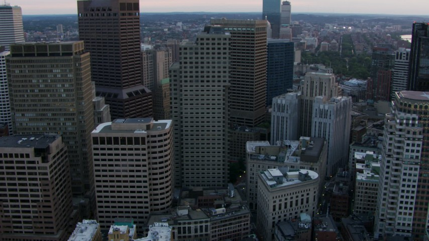 Flyby city skyscrapers and reveal the top of the Custom House Tower in Downtown Boston, Massachusetts, twilight Aerial Stock Footage AF0001_000797 | Axiom Images