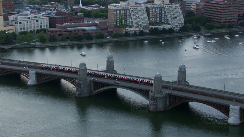 A commuter train crossing the Longfellow Bridge, Boston, Massachusetts, twilight Aerial Stock Footage | AF0001_000803
