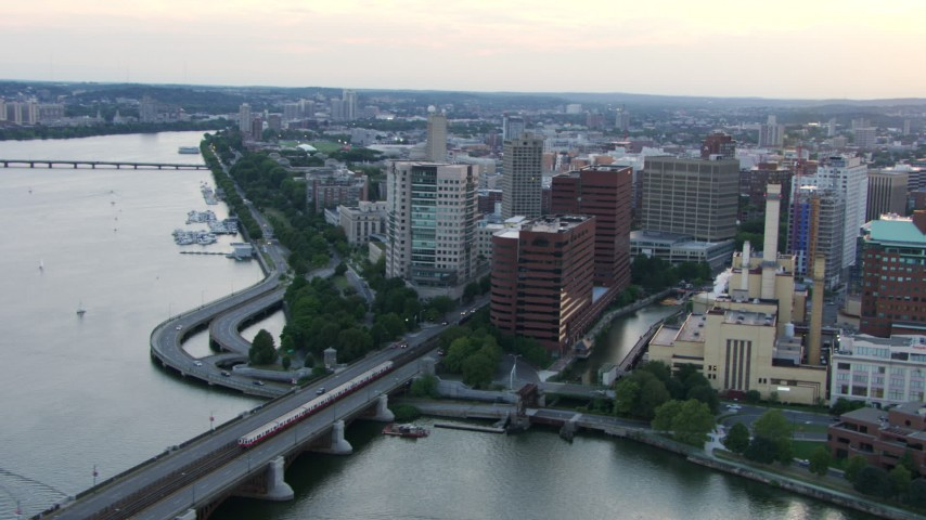 HD stock footage aerial video of a commuter train crossing Longfellow Bridge toward Cambridge, Massachusetts, twilight Aerial Stock Footage | AF0001_000804