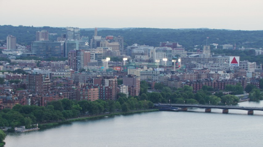 HD stock footage aerial video of Back Bay brownstones and the light of Fenway Park in Boston, Massachusetts, twilight Aerial Stock Footage | AF0001_000806