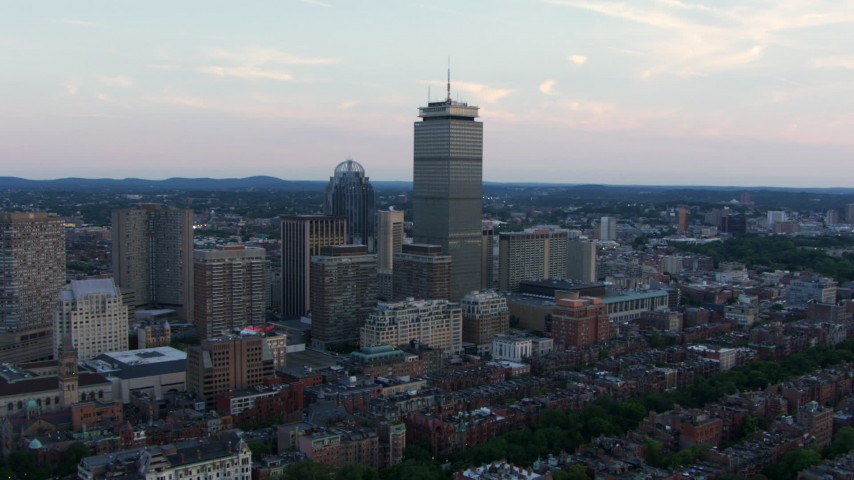 HD stock footage aerial video approach 111 Huntington Avenue and Prudential Tower in Downtown Boston, Massachusetts, twilight Aerial Stock Footage AF0001_000807 | Axiom Images