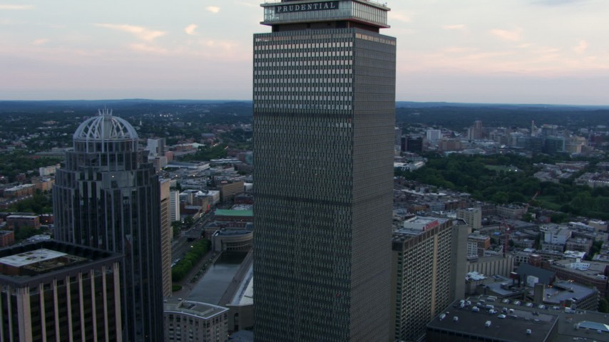 HD stock footage aerial video fly between 111 Huntington Avenue and Prudential Tower to reveal Fenway Park, Downtown Boston, Massachusetts, twilight Aerial Stock Footage | AF0001_000808