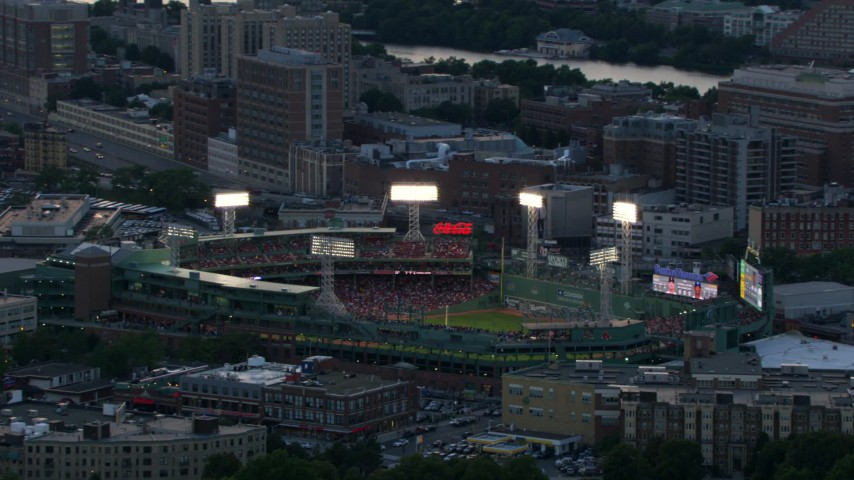 HD stock footage aerial video of Fenway Park with a baseball game in progress, Boston, Massachusetts, twilight Aerial Stock Footage | AF0001_000810