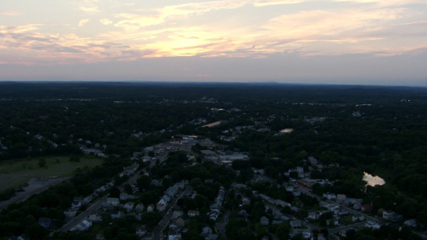 HD stock footage aerial video of suburban homes and the sunset over Dedham, Massachusetts, sunset Aerial Stock Footage AF0001_000815 | Axiom Images