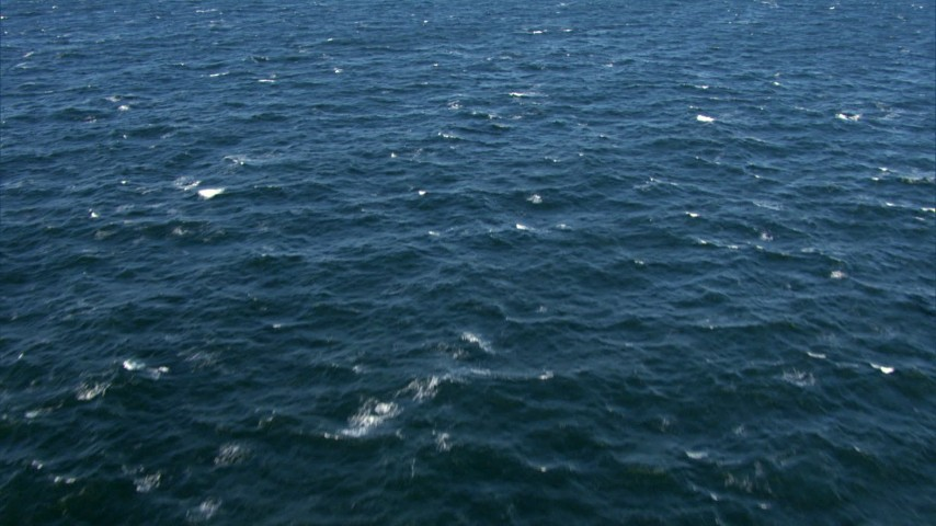 HD stock footage aerial video of a reverse view of the surface of the Atlantic Ocean Aerial Stock Footage | AF0001_000824