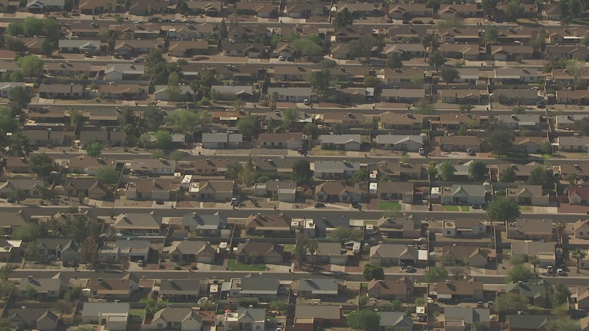 HD stock footage aerial video of rows of homes in a suburban neighborhood in Peoria, Arizona Aerial Stock Footage | AF0001_000829