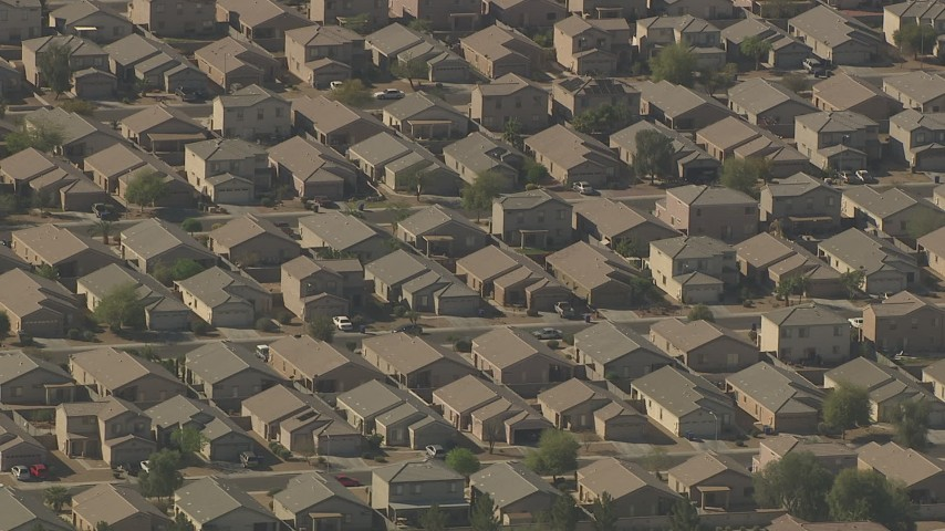 HD stock footage aerial video of flying by rows of tract homes in Surprise, Arizona Aerial Stock Footage | AF0001_000836
