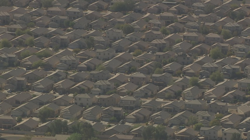 HD stock footage aerial video of tract homes in a suburban neighborhood in Surprise, Arizona Aerial Stock Footage | AF0001_000838