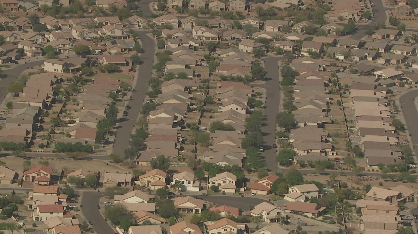 HD stock footage aerial video approach and tilt to tract homes in a residential neighborhood, Surprise, Arizona Aerial Stock Footage | AF0001_000843