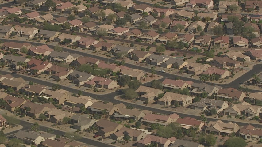 HD stock footage aerial video of rows of one-story tract homes in Surprise, Arizona Aerial Stock Footage | AF0001_000844