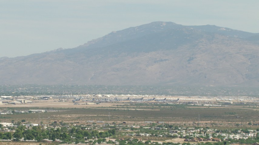 Military airplanes at an aircraft boneyard, Davis Monthan AFB, Tucson, Arizona Aerial Stock Footage | AF0001_000847
