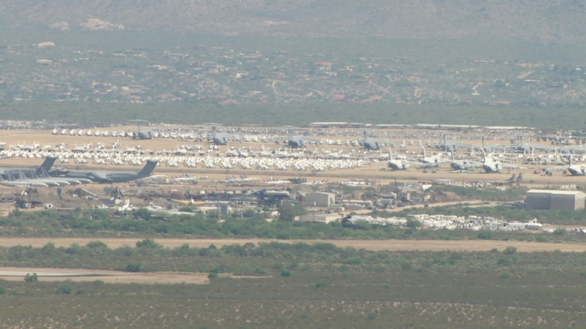 An aircraft boneyard at Davis Monthan AFB, Tucson, Arizona Aerial Stock Footage AF0001_000848 | Axiom Images