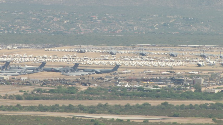 A military aircraft boneyard, Davis Monthan AFB, Tucson, Arizona Aerial Stock Footage | AF0001_000849