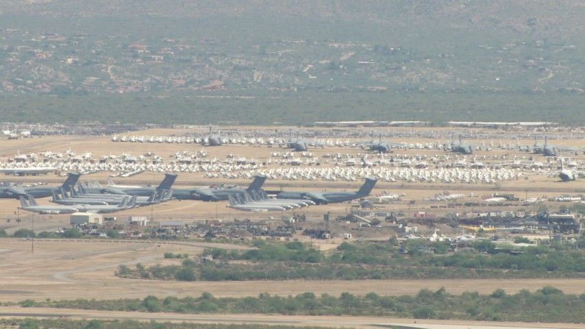 HD stock footage aerial video of a view of airplanes at an aircraft boneyard, Davis Monthan AFB, Tucson, Arizona Aerial Stock Footage | AF0001_000850