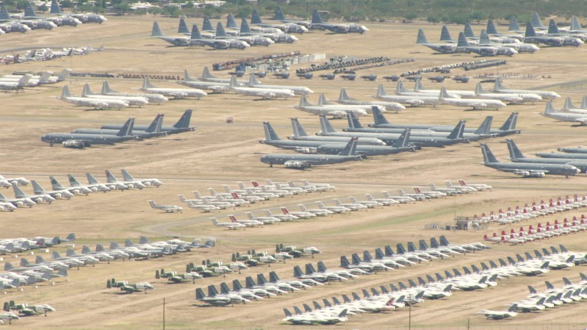 Pan across aircraft parked at the boneyard at Davis Monthan AFB, Tucson, Arizona Aerial Stock Footage | AF0001_000853