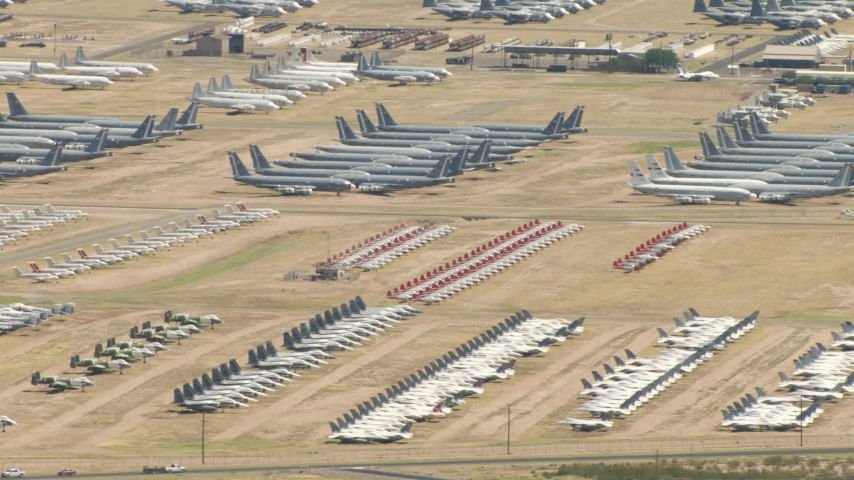 Groups of military airplanes in an aircraft boneyard, Davis Monthan AFB, Tucson, Arizona Aerial Stock Footage | AF0001_000854